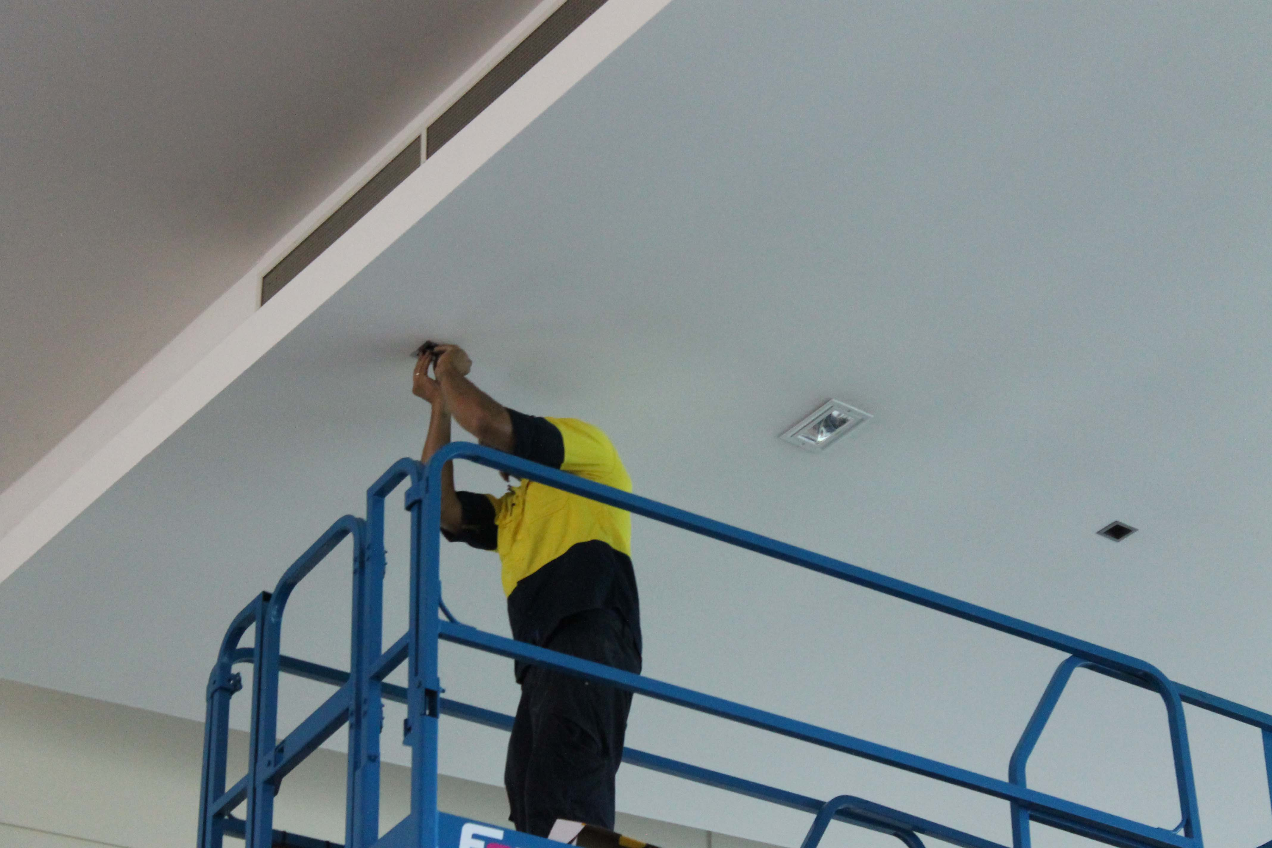 Electrician installing energy efficient LED lights