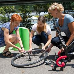 People fixing a bike tyre