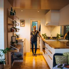 Inside of tiny house with designer standing inside