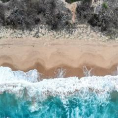 Drone view of ocean waves crashing onshore
