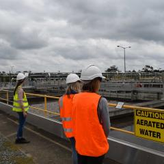 Green Labs representatives inspecting aerated water tanks at water treatment facility