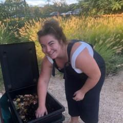 Georgia, President of the UQ Community Garden Club, with the club's worm farm